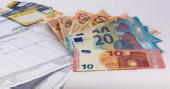 Symbolbild Abrechnung und Geldscheine